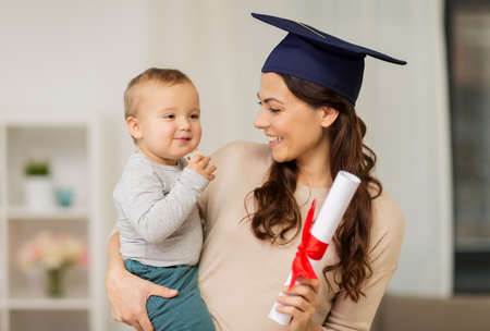 Photo for education, graduation and motherhood concept - happy mother student with baby boy and diploma at home - Royalty Free Image