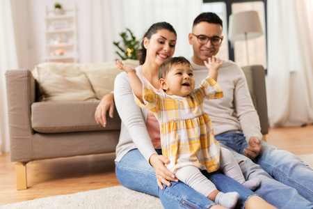 Photo for happy family and baby daughter playing at home - Royalty Free Image