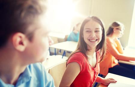 Foto de group of happy students talking at school break - Imagen libre de derechos