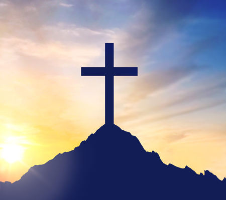 Photo for silhouette of cross on calvary hill over sky - Royalty Free Image