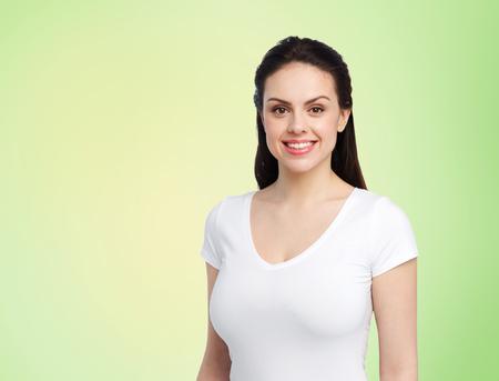 Foto de body positive and people concept - happy woman in white t-shirt over lime green background - Imagen libre de derechos