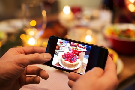 Photo for hands photographing food at christmas dinner - Royalty Free Image