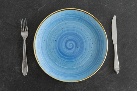 Photo for Close up of plate, fork and knife on table - Royalty Free Image