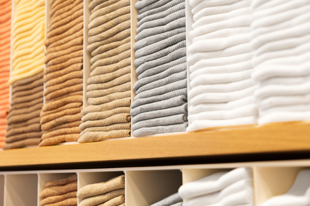 close up of shelves with clothes at clothing store