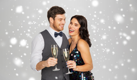 Photo pour happy couple with champagne celebrating christmas - image libre de droit