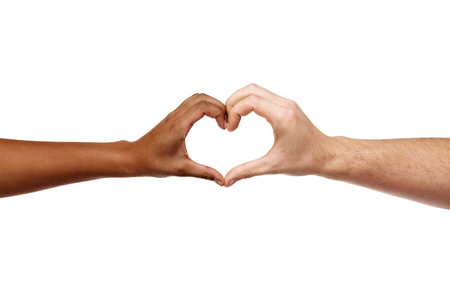 hands of different skin color making heart shape