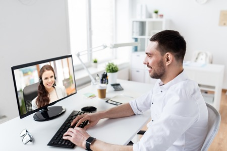 Photo for businessman having video call on pc at office - Royalty Free Image