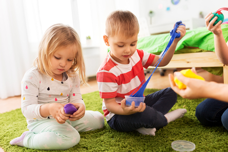 Photo for children with modelling clay or slimes at home - Royalty Free Image