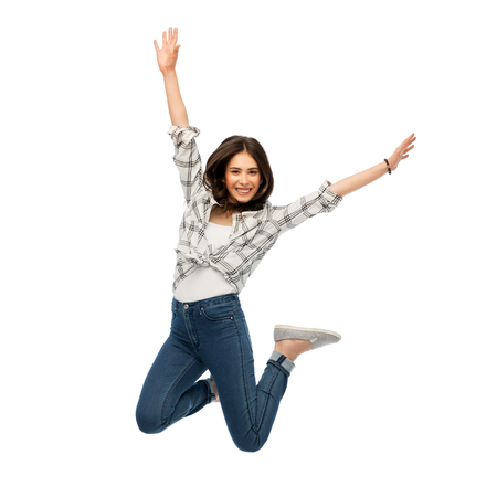 Photo pour happy young woman or teenage girl jumping - image libre de droit