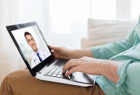 Photo pour patient having video call with doctor on laptop - image libre de droit