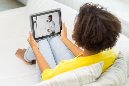 Photo pour woman watching webinar on tablet computer at home - image libre de droit