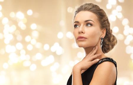 Photo for beautiful young woman wearing diamond earrings - Royalty Free Image