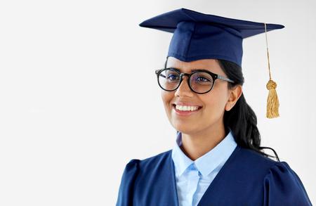 Foto de happy female graduate student in mortarboard - Imagen libre de derechos