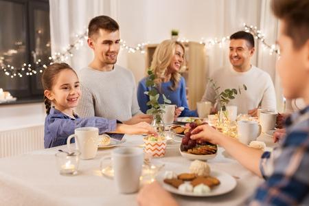 Photo pour Happy family having tea party at home - image libre de droit