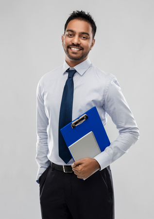 Photo for indian businessman with clipboard and notebook - Royalty Free Image