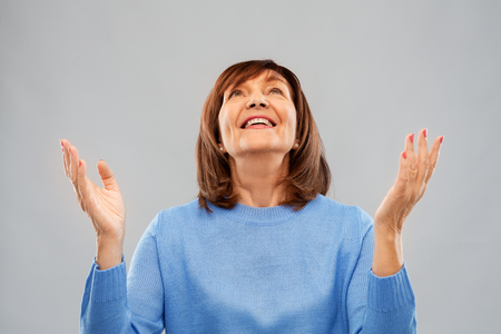 Photo for happy senior woman looking up - Royalty Free Image