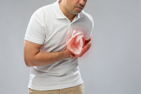 Photo pour close up of man having heart attack or heartache - image libre de droit