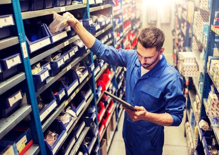 Photo pour auto mechanic or smith with tablet pc at workshop - image libre de droit