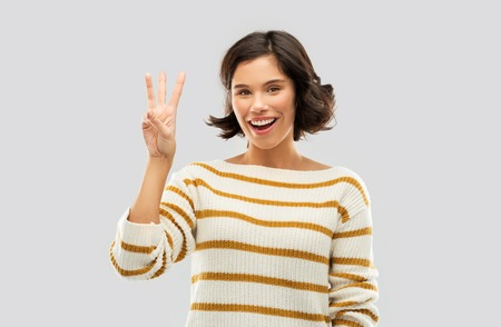 Photo pour happy smiling woman showing three fingers - image libre de droit