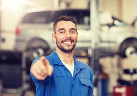 Photo pour happy auto mechanic man or smith at car workshop - image libre de droit
