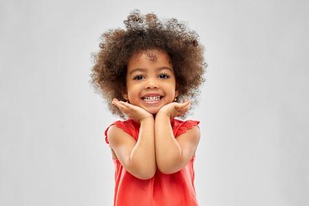 Foto de happy little african american girl over grey - Imagen libre de derechos