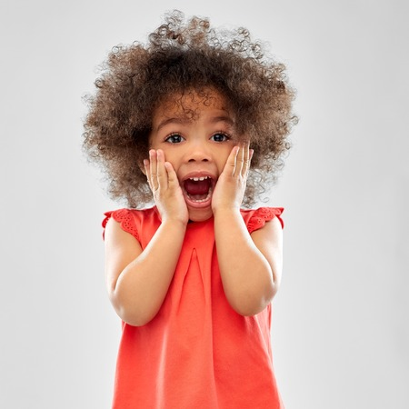 Foto per Surprised or scared little African American girl - Immagine Royalty Free