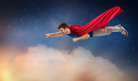 Photo pour man in red superhero cape flying over night sky - image libre de droit