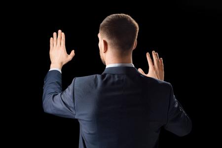 Photo pour businessman working with invisible virtual screen - image libre de droit