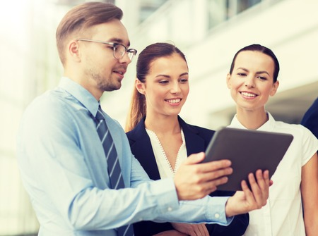 Photo for People, technology, work and corporate concept - Business team with tablet pc computer at office - Royalty Free Image