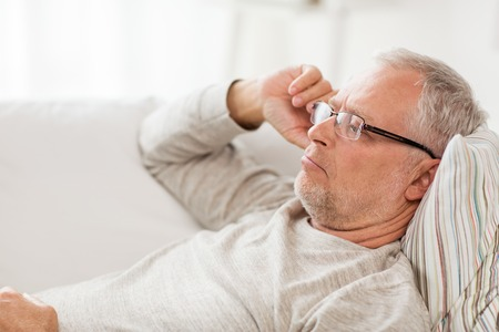 Photo pour Old age, problem and people concept - close up of senior man  lying on sofa and thinking at home - image libre de droit