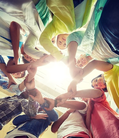 Photo for education, school, teamwork and people concept - international students making circle of hands - Royalty Free Image
