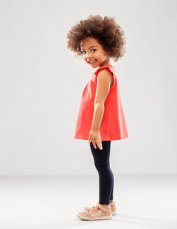 Foto per Happy little African American girl over grey - Immagine Royalty Free
