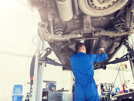 Photo pour mechanic man or smith repairing car at workshop - image libre de droit