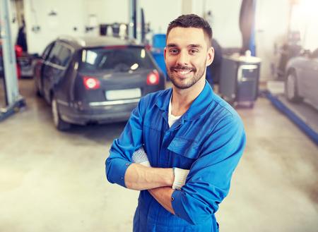 Photo pour Happy auto mechanic man or smith at car workshop - image libre de droit