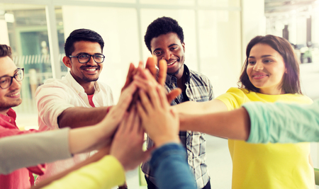 Photo for Group of international students making high five - Royalty Free Image