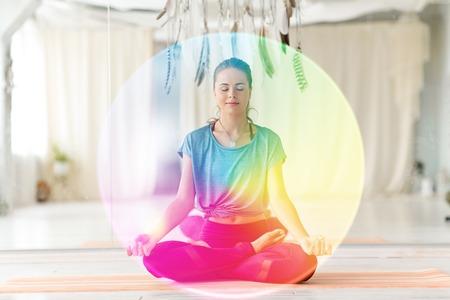 Photo pour Woman meditating in lotus pose at yoga studio - image libre de droit