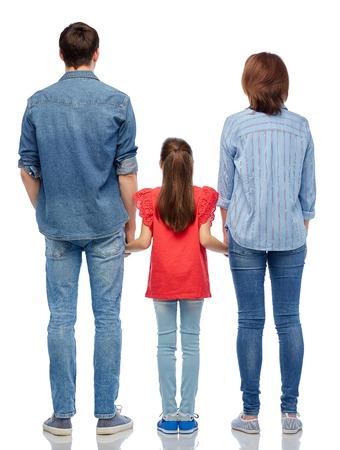 Photo pour family and people concept - mother, father and little daughter holding hands over white background from back - image libre de droit
