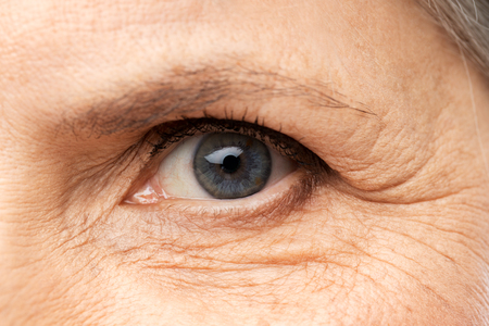 Photo pour Vision, beauty and old age concept - close up of senior woman eye - image libre de droit