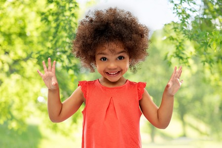 Foto de happy little african american girl in summer - Imagen libre de derechos