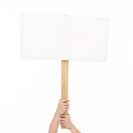 Photo for people, advertisement and sale concept - female hands holding blank white board on stick - Royalty Free Image