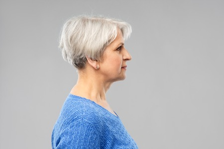 Photo pour old people concept - portrait of senior woman in blue sweater over grey background - image libre de droit