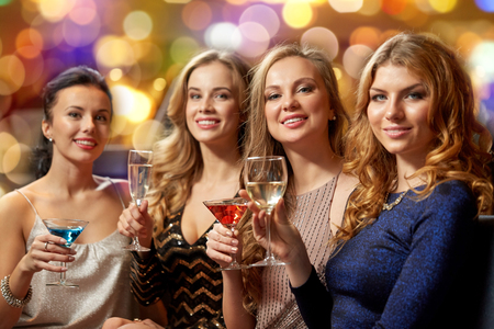 Photo for celebration, bachelorette party and holidays concept - happy women or female friends with non-alcoholic drinks in glasses at night club - Royalty Free Image