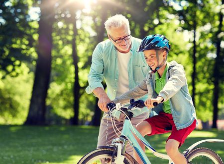 Photo for grandfather and boy with bicycle at summer park - Royalty Free Image