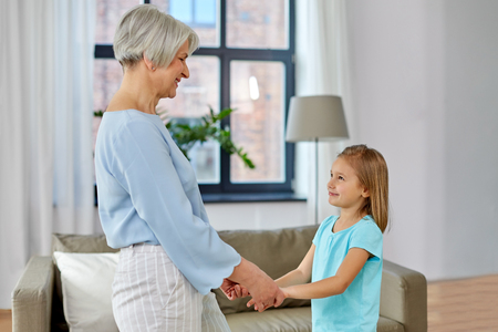 Photo pour grandmother and granddaughter holding hands - image libre de droit