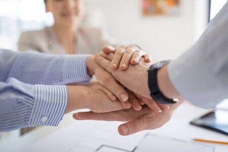 Foto de close up of business team stacking hands - Imagen libre de derechos