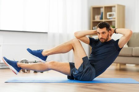 man making bicycle crunch exercise at home