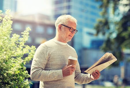 Photo for senior man reading newspaper and drinking coffee - Royalty Free Image