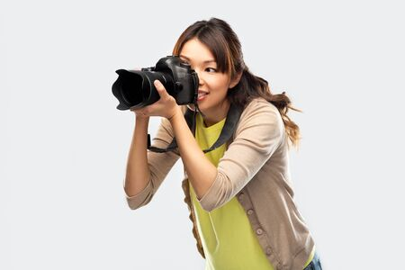 Photo for asian female photographer with digital camera - Royalty Free Image