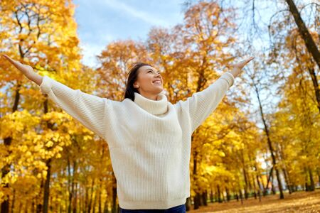Photo for Beautiful happy young woman in autumn park - Royalty Free Image