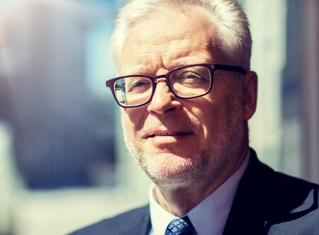 Photo pour business and people concept - close up of senior businessman in eyeglasses and suit - image libre de droit